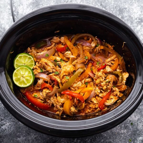 close up shot of chicken fajitas in the slow cooker