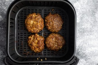cooked burgers in air fryer basket