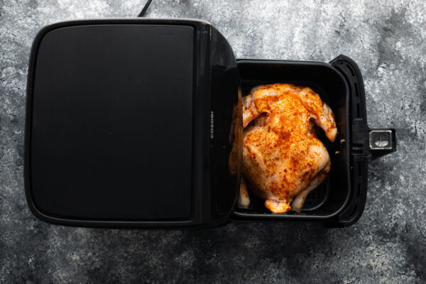 whole chicken in air fryer, breast side down, before cooking