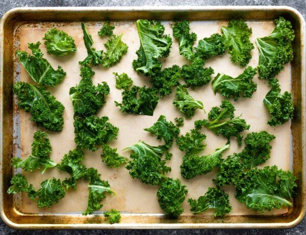 kale chips spread out on sheet pan