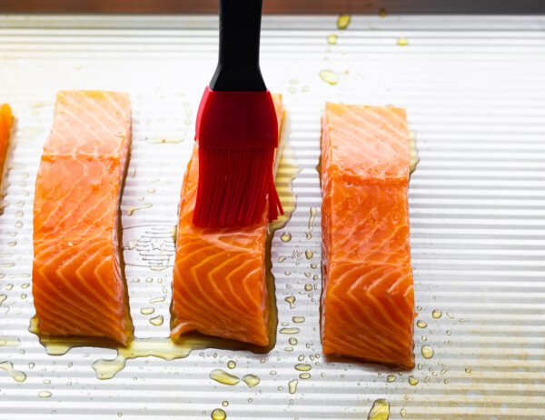 brushing salmon with olive oil