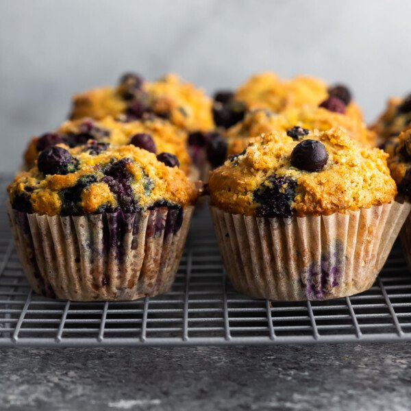 side angle view of blueberry muffins on wire rack