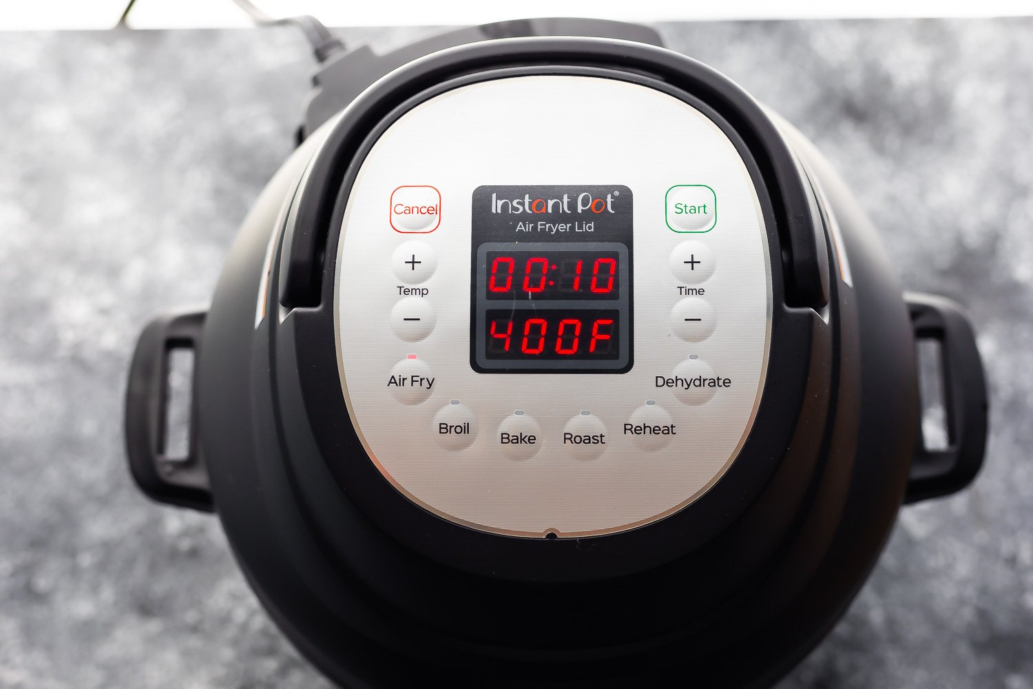 overhead view of instant pot air fryer lid with 10 min on timer