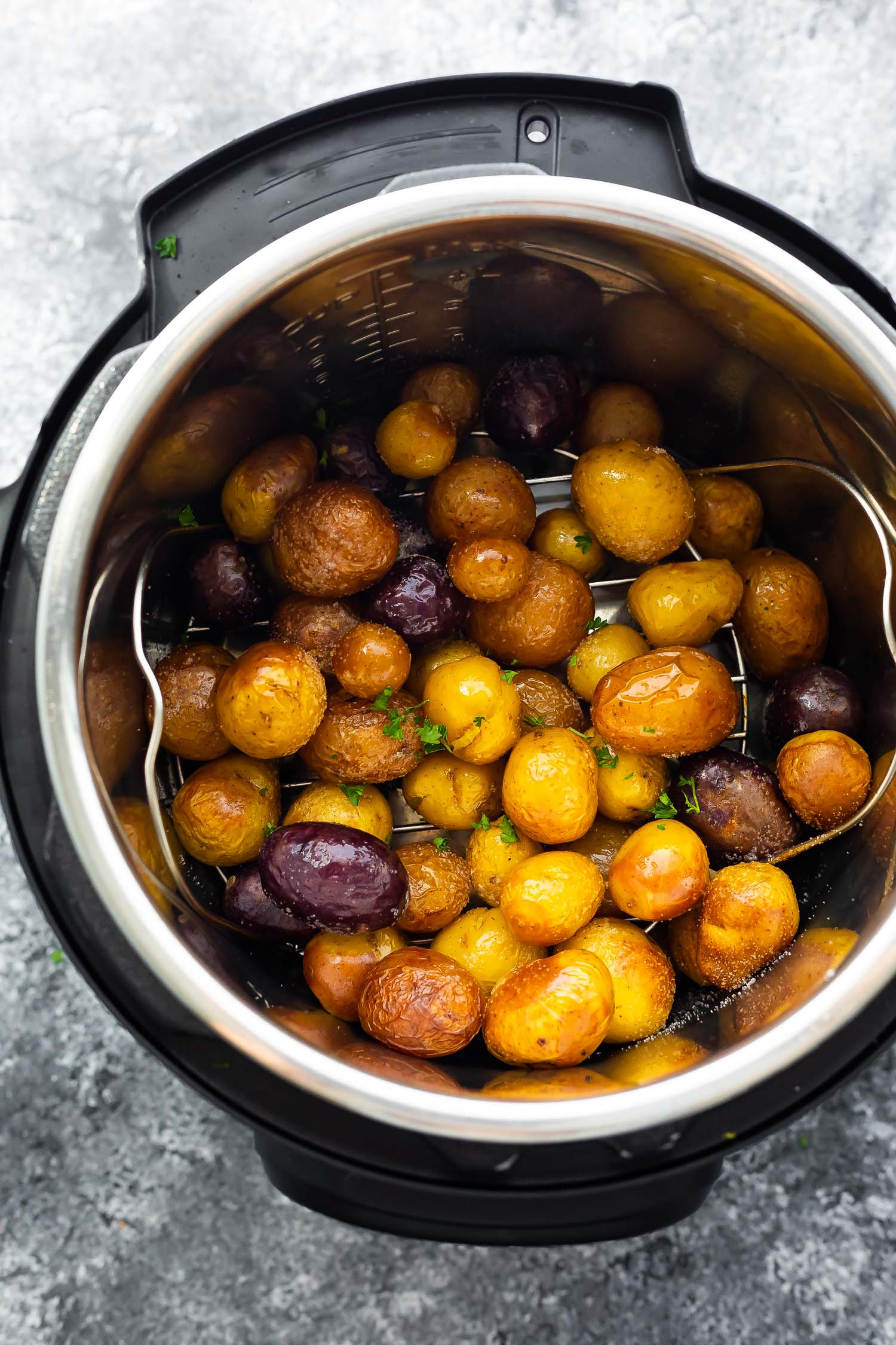 overhead view of baby potatoes in instant pot after cooking and air frying