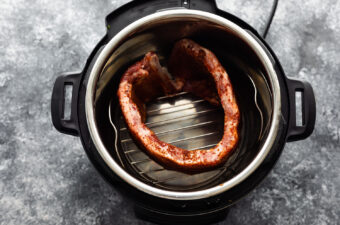 overhead view of ribs on trivet in instant pot