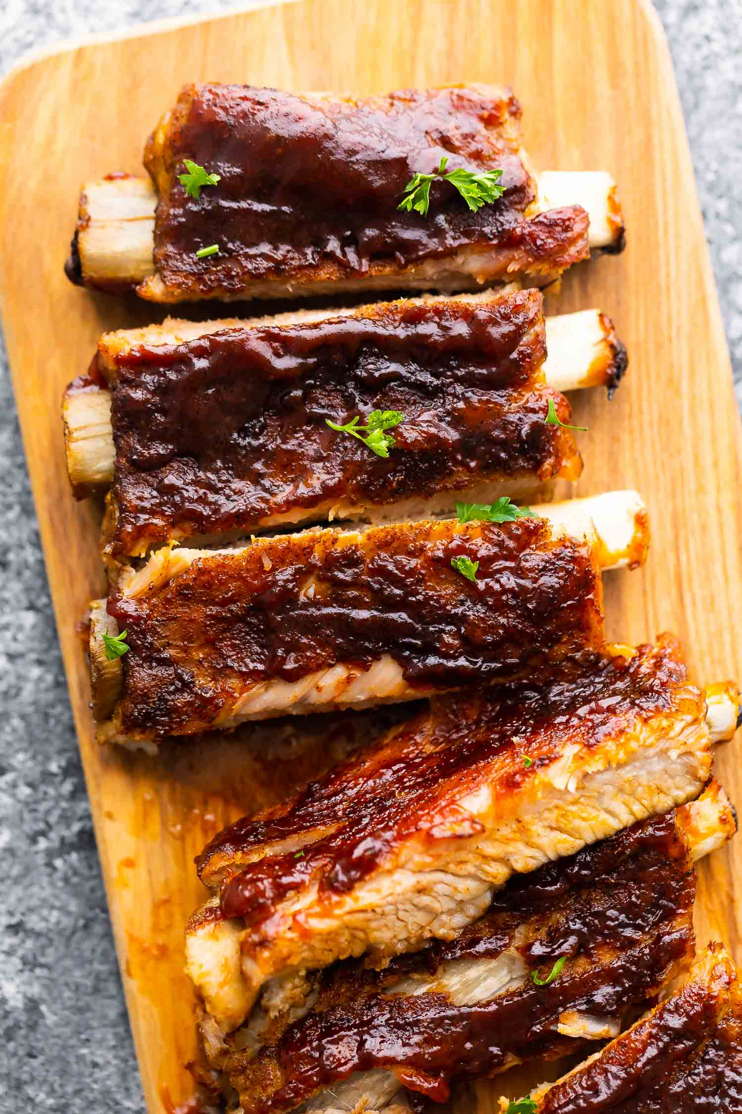 close up view of instant pot ribs, cut and laid out on cutting board