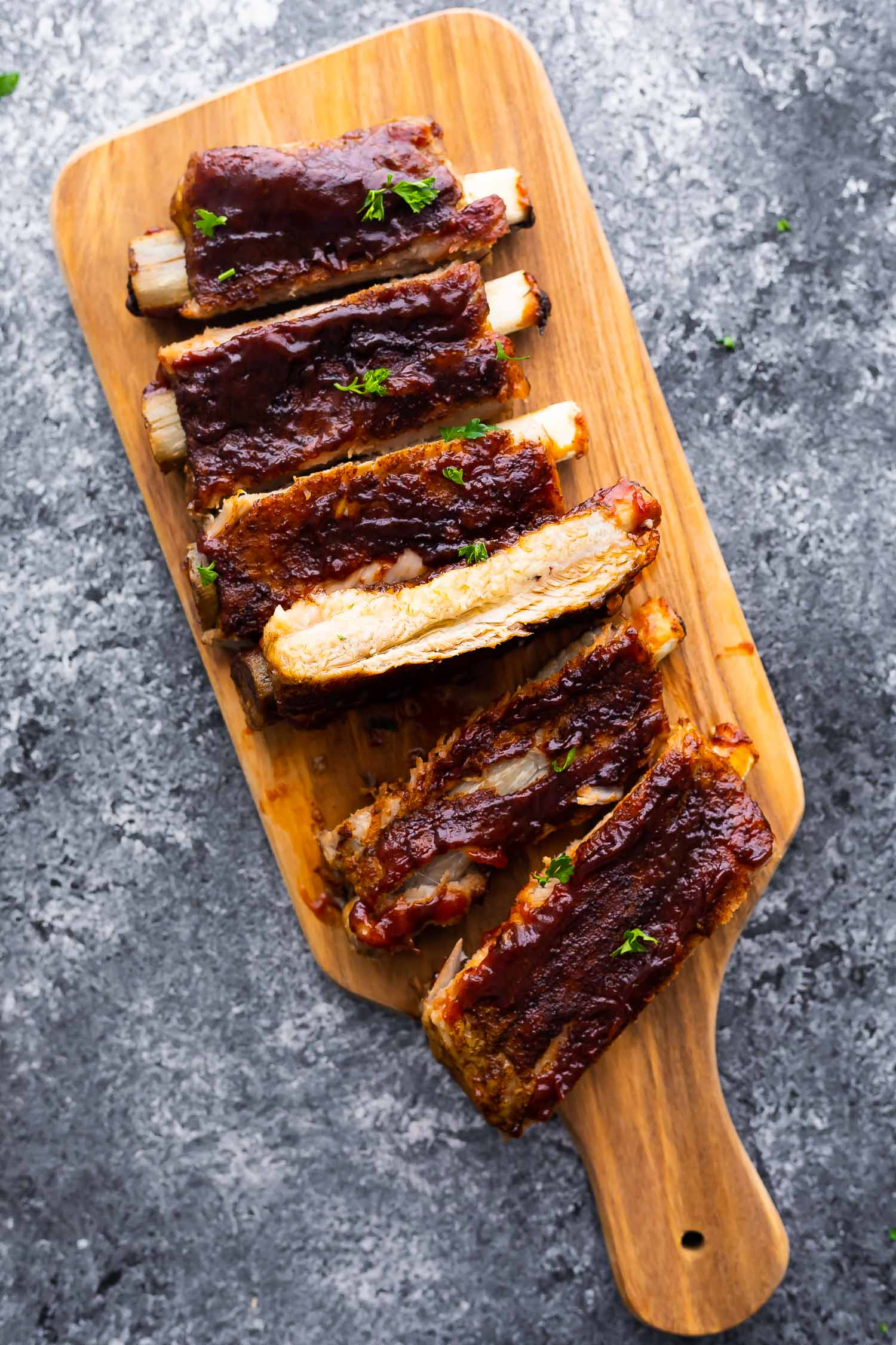 overhead view of instant pot ribs, cut and laid out on cutting board