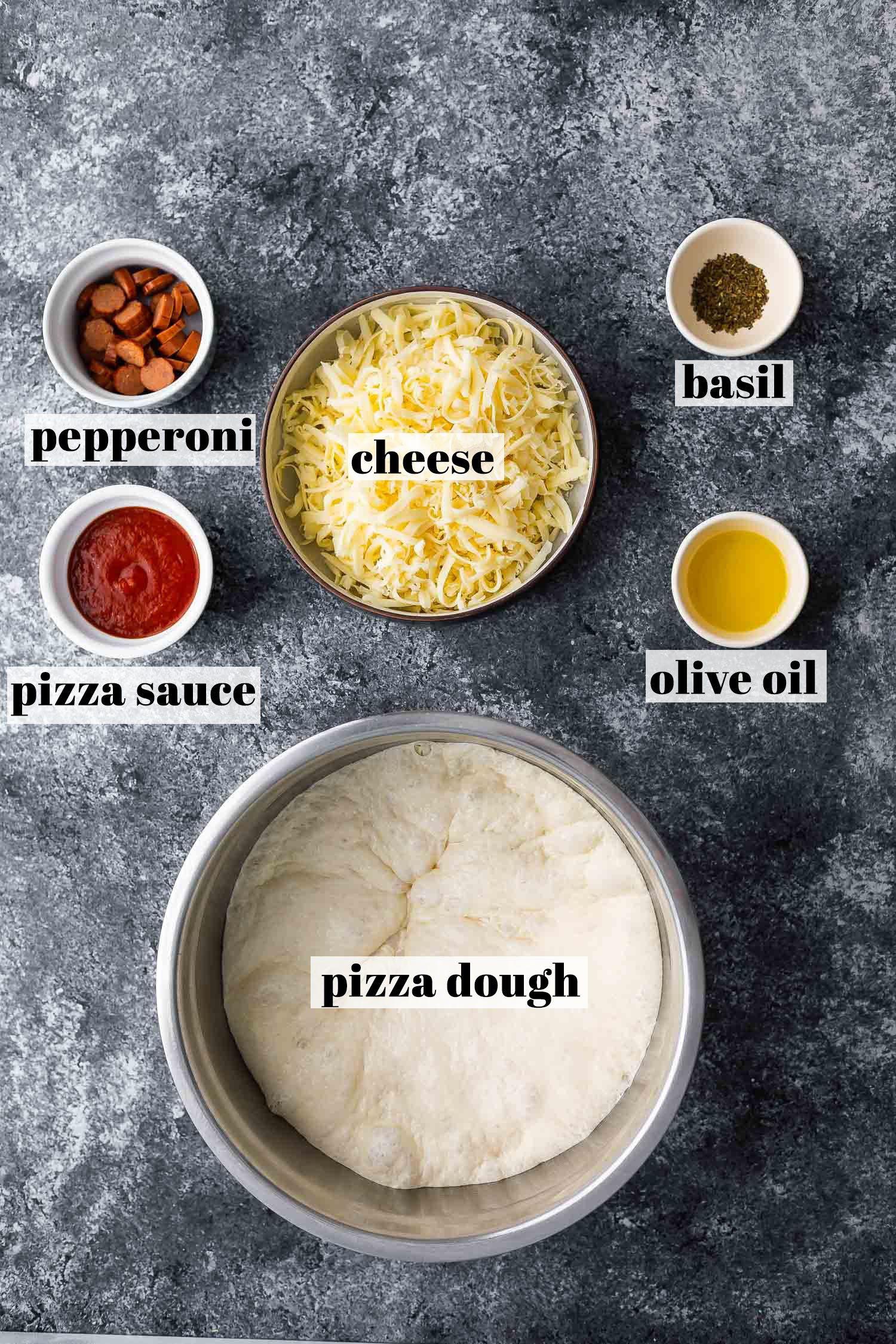 overhead view of ingredients required to make air fryer pizza