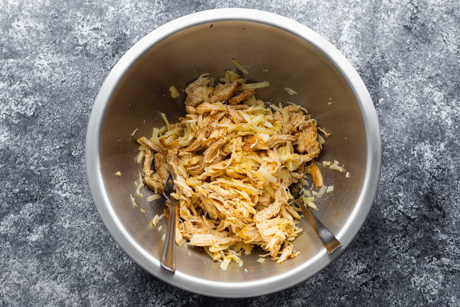 shredded chicken and cheese tossed together