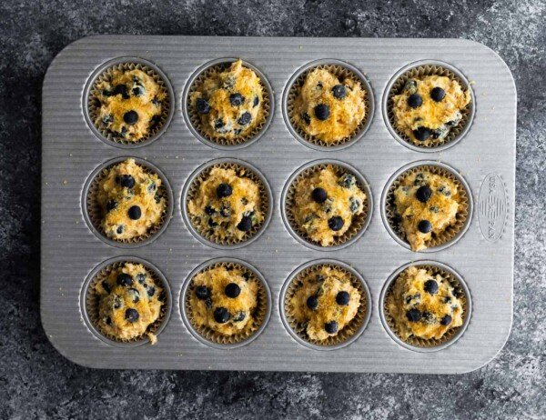blueberry muffins in muffin pan before baking
