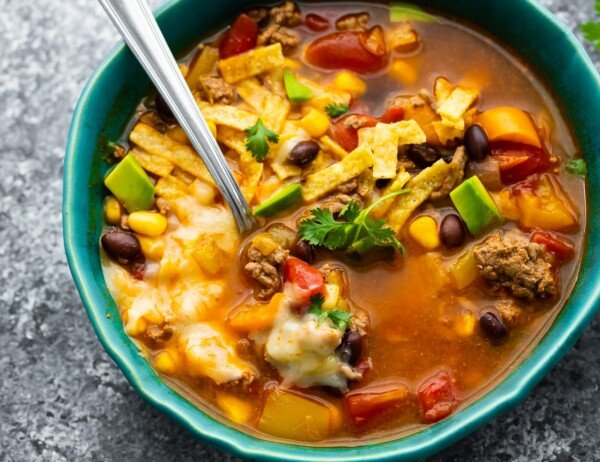 overhead view of taco soup in a bowl with spoon