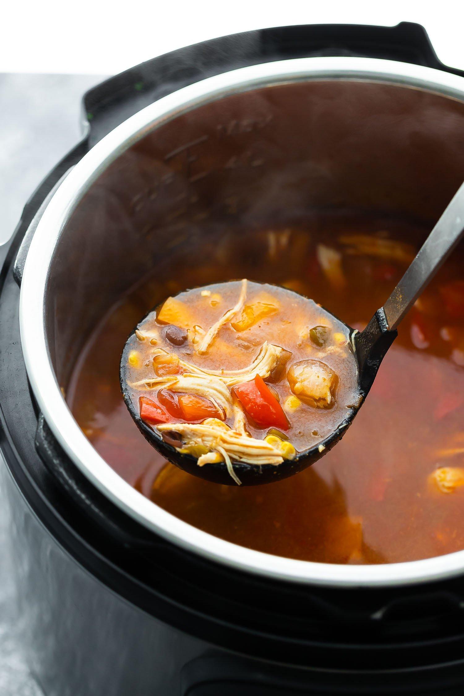 soup ladle lifting tortilla soup out of the instant pot