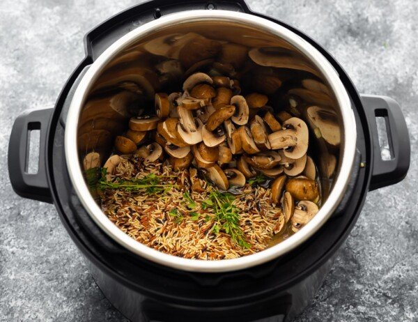 ingredients for wild rice pilaf in the instant pot before cooking through