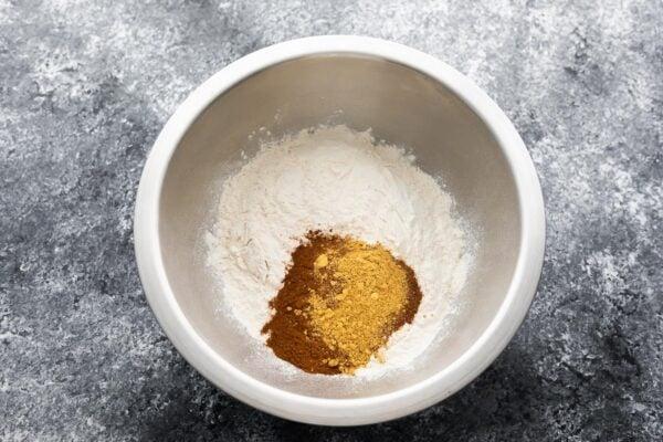 dry ingredients for pumpkin pancakes in silver bowl