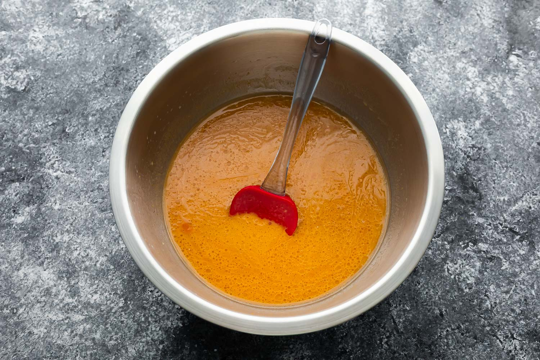 wet ingredients for pumpkin pancakes in silver bowl