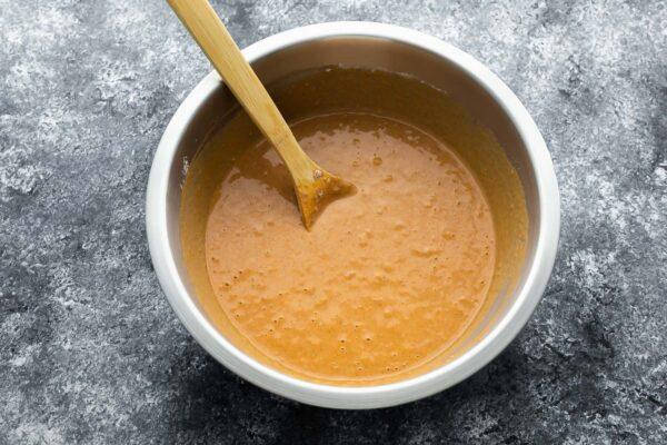 pumpkin pancake batter in silver bowl