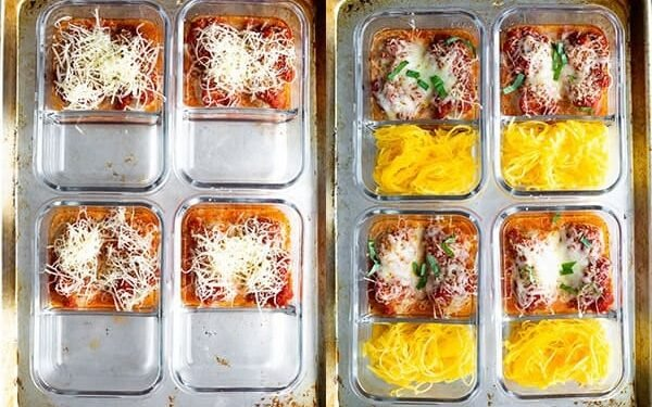 overhead shot of four meal prep containers with marinara sauce and meatballs after baking, with melted cheese on top