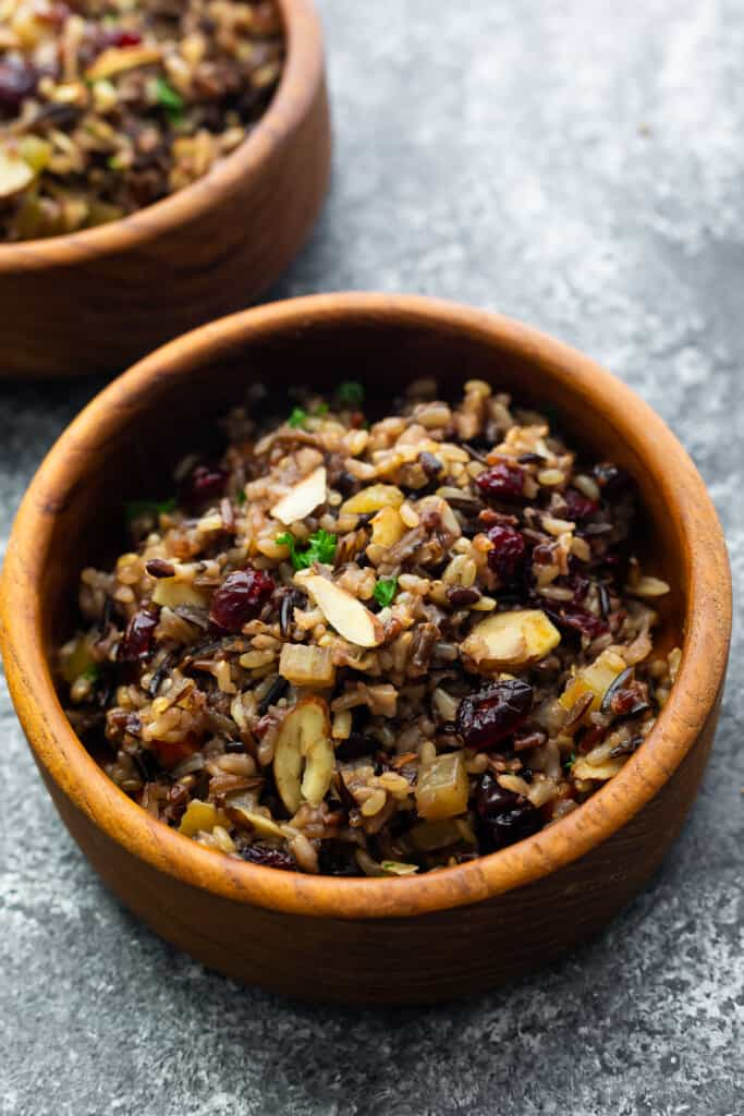 close up view of wild rice pilaf in brown bowl after cooking