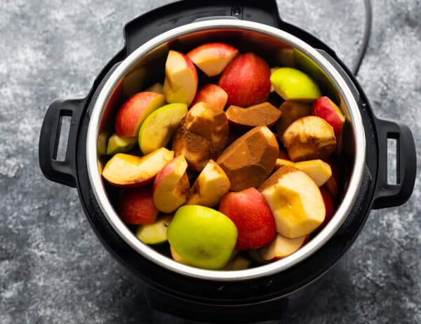 overhead view of instant pot filled with apples and cinnamon