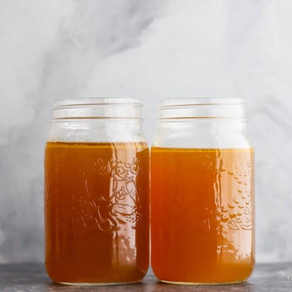two jars of chicken stock