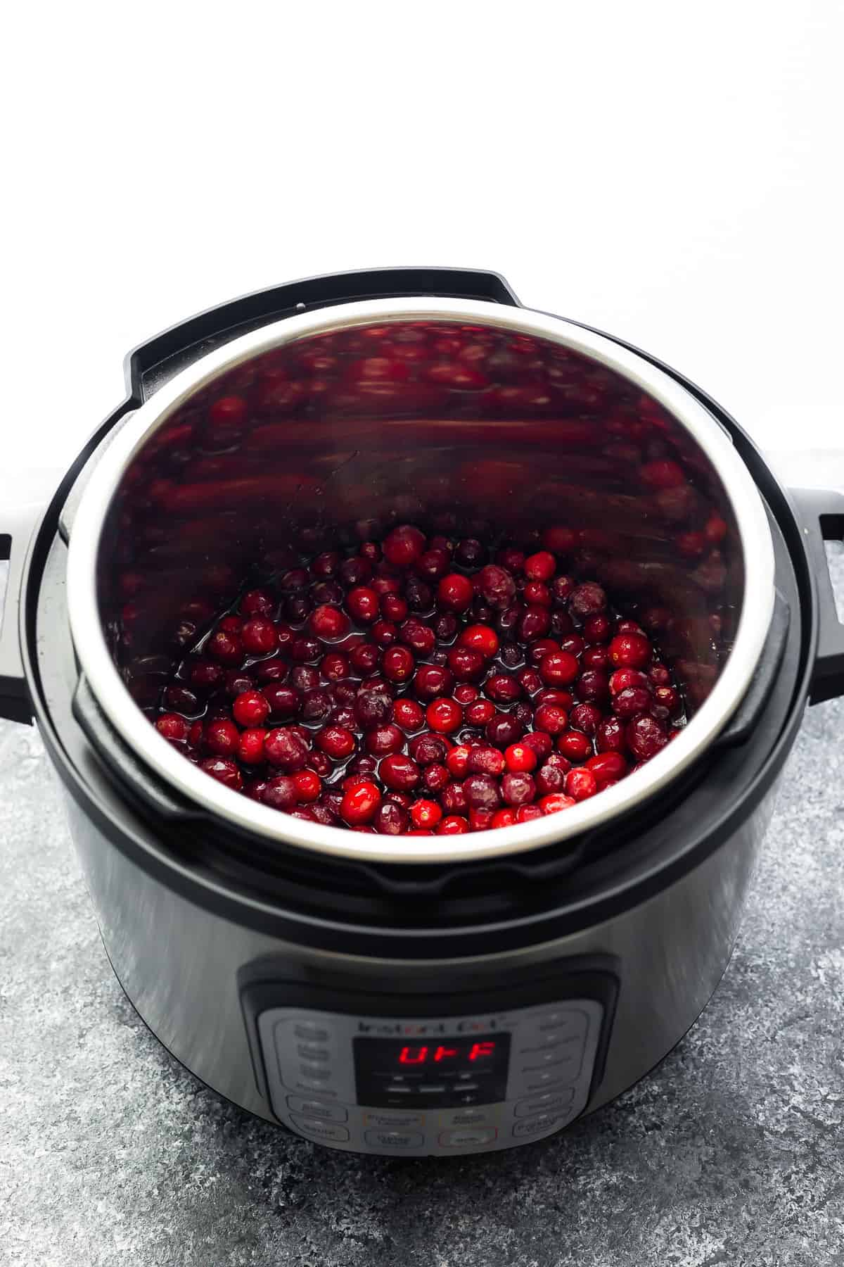 cranberry sauce ingredients in the instant pot before cooking