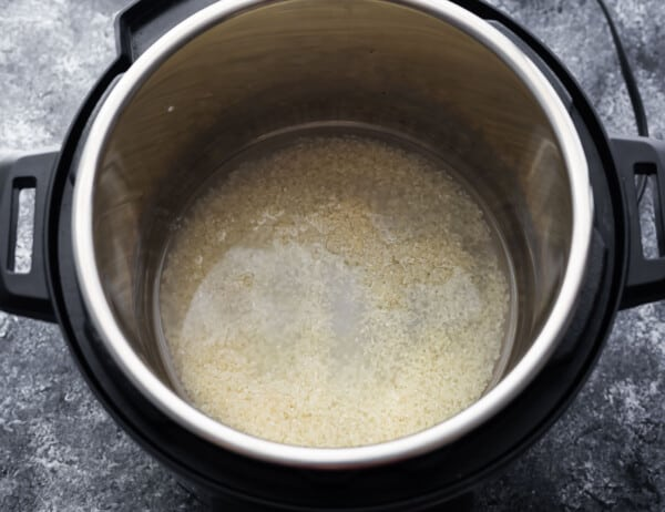 ingredients for sushi rice in the instant pot before cooking