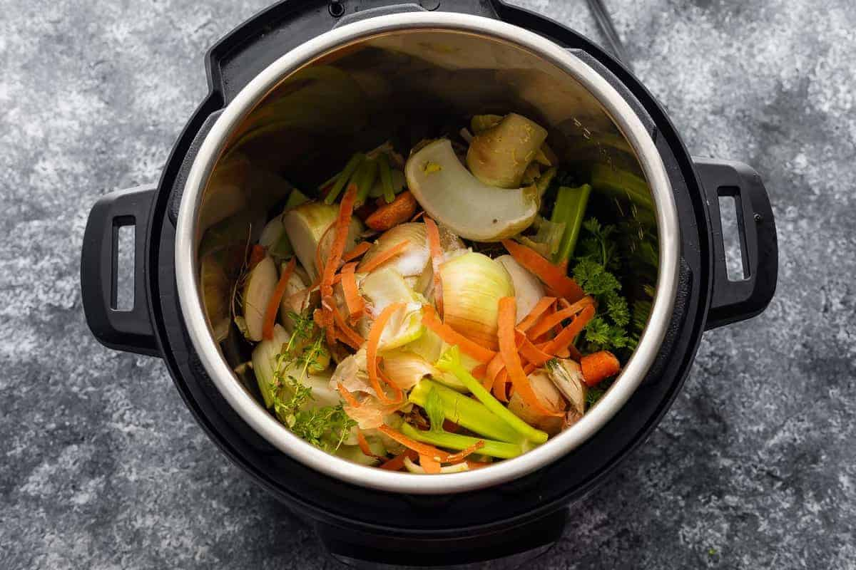 vegetable stock ingredients in instant pot before cooking