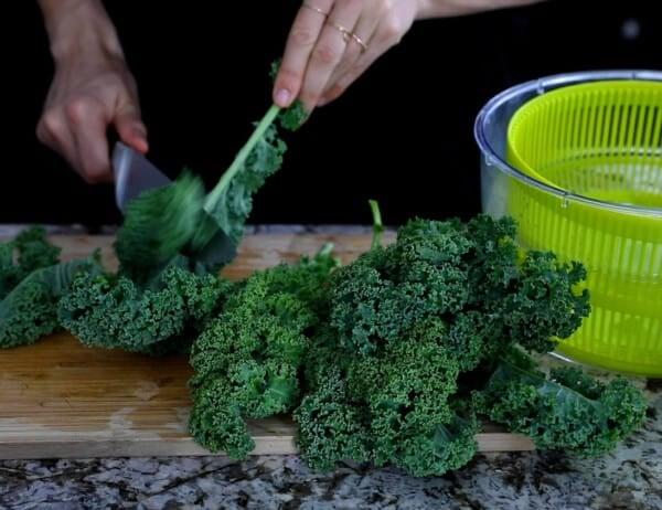 shredding kale from stem using a paring knife